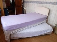 Single divan 2 in 1 guest bed with mattresses and 1 pink headboard.