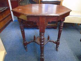 vintage dark wood octagon table on casters.