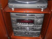 mahogany hifi cabinet with doors plays cd, tapes,and vhf radio plus 33rpm records