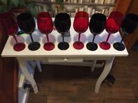 4 red and 4 black wine glasses