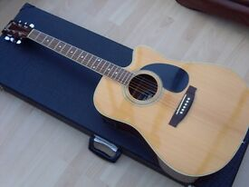 Electro acoustic guitar by Vintage