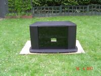 Black Veneered TV Stand with a Smoked Glass Door. Can Deliver.