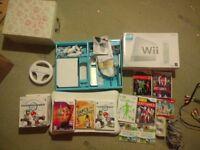 Nintendo Wii + Wii fit board + Mario kart