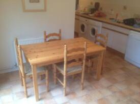 Pine kitchen table and 4 chairs.