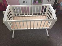 Selling a white swing crib cheap