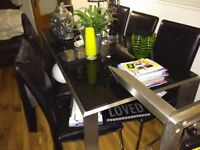 Black Glass And Chrome Table, 6 Chairs.