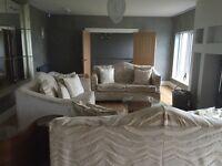 Three matching 3 seater cream sofas