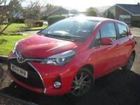 Toyota Yaris, automatic, red, 5 door, petrol.
