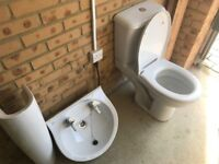 Used toilet and sink with pedestol.