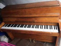 Really nice condition piano, not as big as normal. Nice piece.