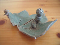 Perry Marsh Pottery, Helston, Cornwall ceramic green glaze caterpillar and snail on leaf. £2.
