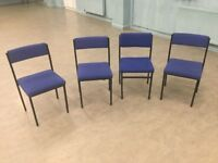 Four blue cloth metal stacking chairs ..
