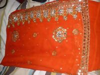new orange indian sari with mirror work