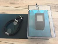Fitbit surge large in box with charger