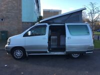 Nissan Elgrand 4 berth camper conversion with kitchen, rock n roll bed & pop up roof.