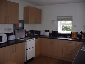 Rooms available in a six bedroomed house would suit students
