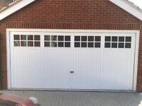 Double garage door 16 x7 feet.