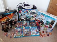 Wii U with 6 games and Disney Infinity 1 and 3 plus extra figures