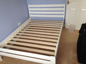 Wooden frame double bed with mattress