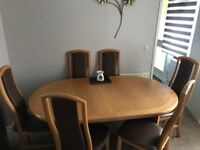 Extending dinning table and 6 chairs