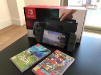 Nintendo Switch + Zelda Breath of the Wild + Mario Odyssey LIKE NEW