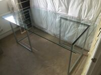 Glass table with trestles