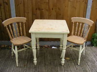 Pine table and two chairs. Painted legs. Good solid table. Bargain