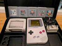 Nintendo Gameboy original + 5 games, carry case, mag light and rechargable battery unit