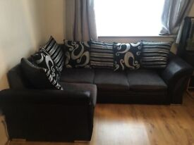 Black sofa and footstool