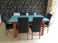 Stunning cherry wood and glass dining table with 6 leather chairs