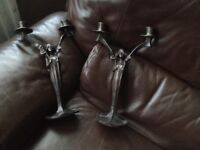 2 old candle sticks