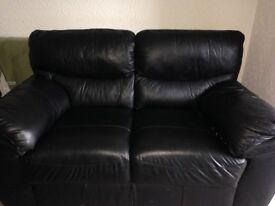 3 & 2 black leather sofa