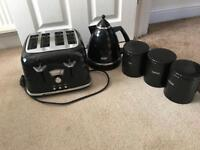 Black delonghi toaster, kettle and tea coffee sugar canisters