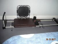 4 CORD PILATES PERFORMER WITH ADDED REBOUNDER BOARD.