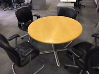 small round table with four chairs