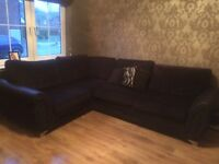Black Right hand material corner couch from DFS
