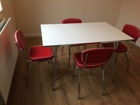 50's Retro Style Table And 4 Chairs - Red Chairs / White Table. Very Good Condition