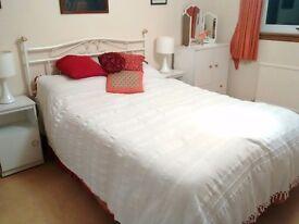 Double divan bed with metal headboard