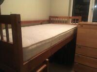 Raised single wood bed