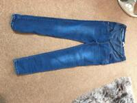 Maternity jeans over bump, size 14.