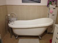 Roll top free standing bath with chrome Victorian style taps and claw feet for sale