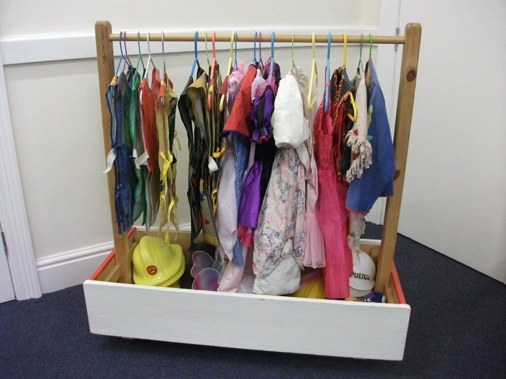Wooden clothes rail with assorted childrens dressing up outfits
