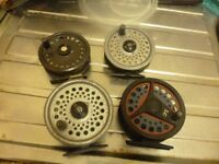 four fly fishing reels all working