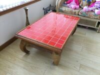 Solid wood coffee table with red tiled top