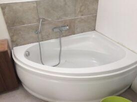 Corner bath and panel