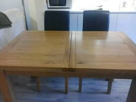 Solid light oak dining table with 4 chairs