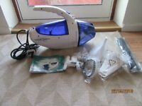 STEAM AND VACUUM CLEANER (STEAM GENIUS BY HOME WELL)