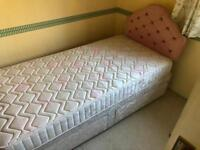 Single bed with mattress and 2 drawers and headboard. Can deliver.