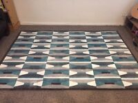 Large blue, white and grey patterned IKEA area rug for living room