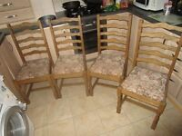 SET OF FOUR OAK DINING CHAIRS IN GOOD CONDITION.